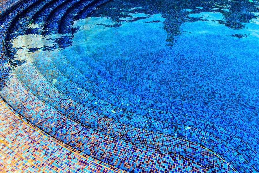 The classic splendor of tiled and mosaic swimming pools in for Pool tile designs