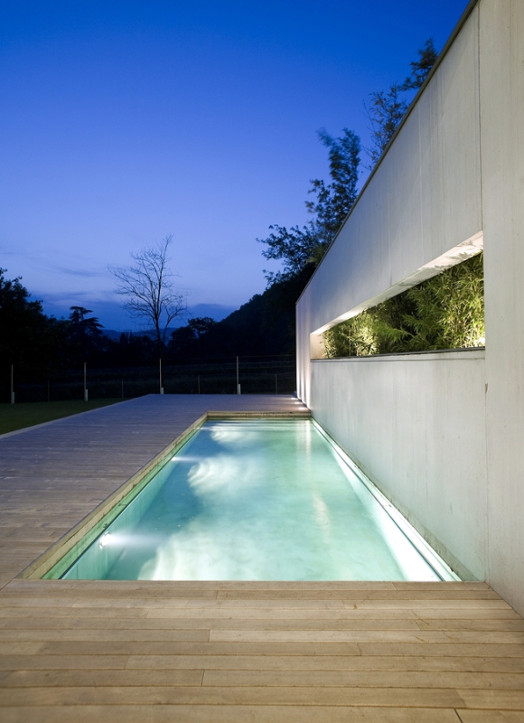 A contemporary home with a plaster-finished pool
