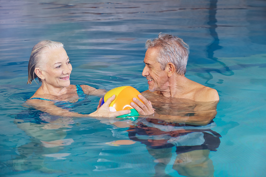 A senior couple enjoying the pool